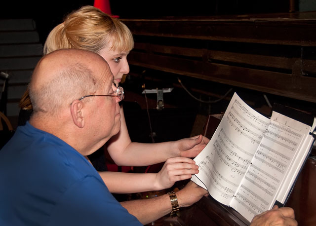 Jim Coleman and Amanda Melhuish go over music for Amanda's onstage singing audition