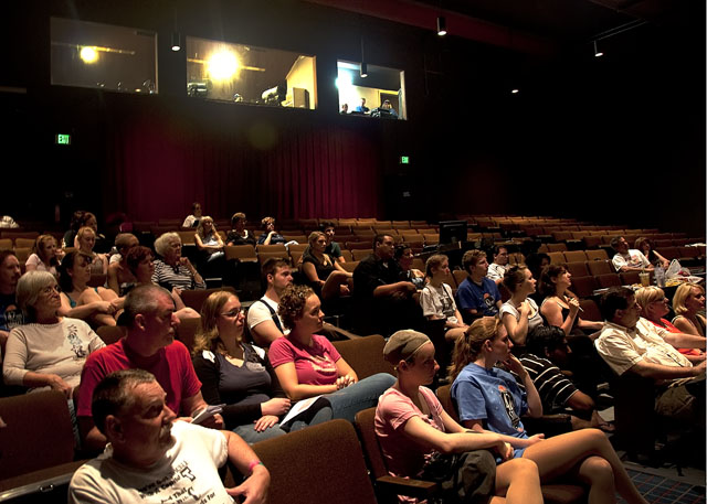 """The cast and crew for 42ND STREET sit in house seats as they hear director Jim Coleman give the first instructions for """"Tech Weekend."""" Beginning June 29, audiences can see these actors in full costume and makeup at the Preview and Opening Nights."""