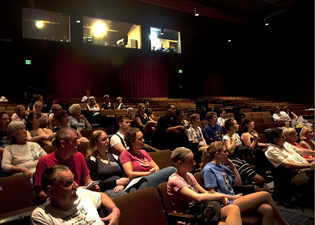 """The cast and crew for 42ND STREET sit in house seats as they listen to director Jim Coleman give his first instructions for """"Tech Weekend."""" Beginning next Wednesday, June 29, you can see them in full costume and makeup at the Preview and Opening Nights."""