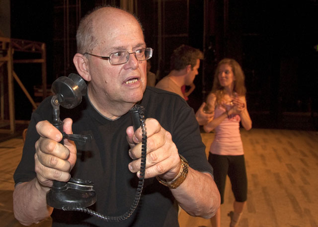 Director Jim Coleman demonstrates use of an old-fashioned handset at an early 42ND STREET rehearsal.