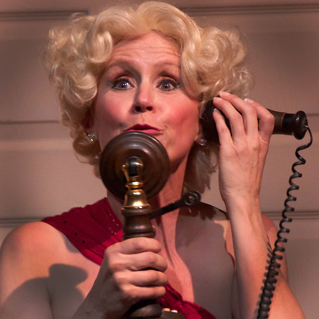 Melissa Esau, as Dorothy Brock, uses an antique phone to search for her missing lover.